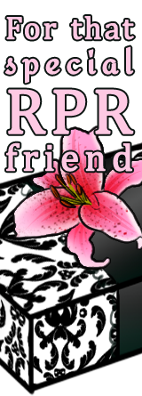 A gift in fancy black and white wrapping paper, wrapped with a black ribbon and adorned with a pink stargazer lily. Text reads: For that special RPR friend