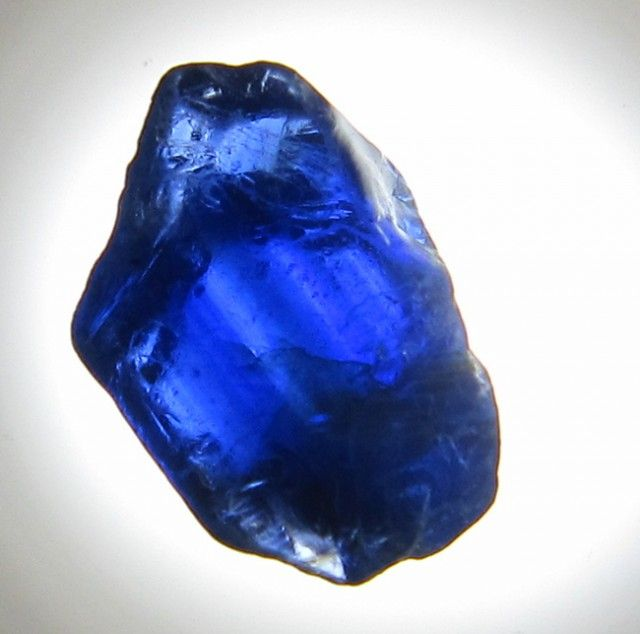 This stone (Sapphire) would be cut, enchanted, and then slotted into the dragon's eye. (See pt. 2)(Credit to the Artist)